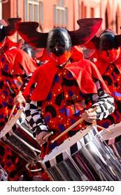 Marktplatz, Basel, Switzerland - March 13th, 2019. Portrait of a carnival snare drummer in red costume