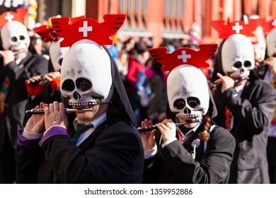 Marktplatz, Basel, Switzerland - March 13th, 2019. Portrait of carnival piccolo players wearing skull shaped masks