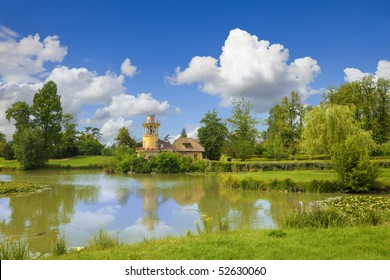 The Marlborough Tower and pond in Marie-Antoinette's estate. Versailles Chateau. France