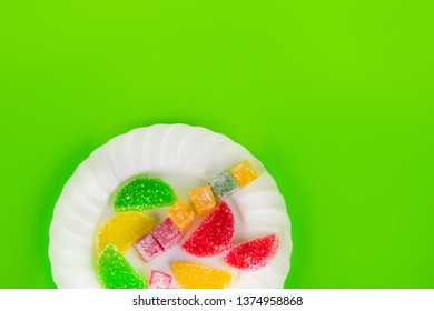 Marmalade and delight on a green background. Turkish sweets Multi-colored marmalade. Sweet fruit lemon marmalade. Jelly candies. Eastern sweets. Turkish delicacies.