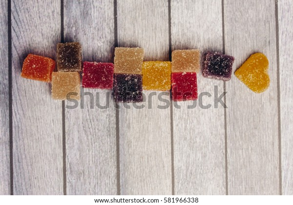 Marmalade on a wooden background.