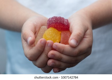 Marmalade sweets in child hands