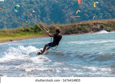 Marmaris, Akyaka, Turkey. July 1, 2019: Group of people are kite surfing in Akyaka region of Marmaris town, in Turkey. kite surfer rides the waves on the famous Akyaka Beach used for Kiteboard sports