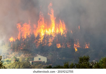 Marmaris, Mugla, Turkey – August 2, 2021.  Flames of forest fire in Hisaronu neighbourhood of Marmaris resort town in Turkey, on August 2, 2021.