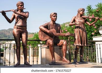 Marmaris, Turkey - 07.12.2019: city sculptures,  music trio, summer day