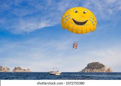 Marmaris, Turkey - 17 August, 2017: A pair of people having fun while paragliding in the sky at Turkish resort in summer.