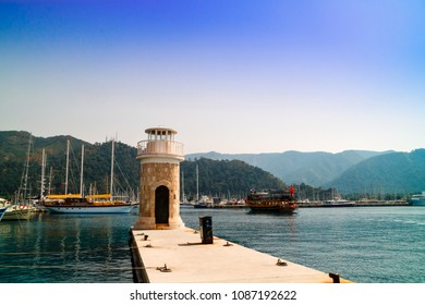 MARMARIS, TURKEY - APRIL 12, 2018: Waterfront with the old lighthouse in Marmaris in Turkey.
