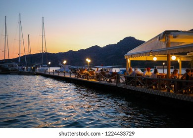 MARMARIS, TURKEY - JUL 2, 2018: People rest in cafe near sea at evening, Russians took first place in number of tourists in Turkey in 2018