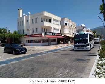 MARMARIS - TURKEY - JULY 2017: The shuttle bus is moving along the route. Urban transport, street scene