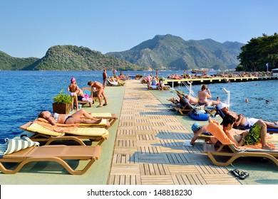 MARMARIS, TURKEY - JULY 24, 2013: Tourists at a popular Mediterranean resort on July 24, 2013 in Marmaris, Turkey.