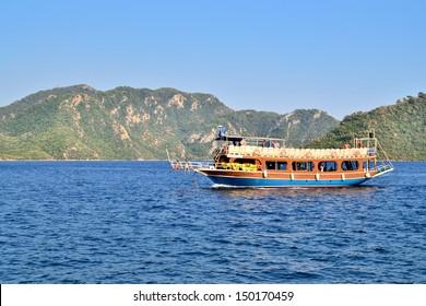 MARMARIS, TURKEY - JULY 24, 2013: Turkish houseboat with tourists at a popular Mediterranean resort on July 24, 2013 in Marmaris, Turkey.