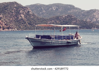 MARMARIS, TURKEY - June 17: Unknown man driving the boat on June 2015 in Marmaris, Turkey. Image includes a vintage effect.