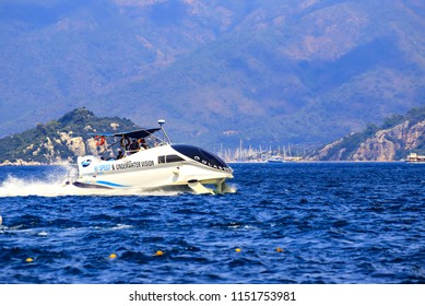 Marmaris in Turkey, June 27, 2018. Speed boat in underwater wings, with passengers floating on the water in the Aegean Sea