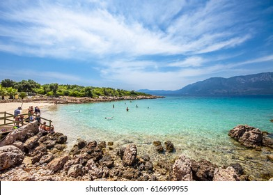 Marmaris, Turkey - May26, 2014 : People are swimming at Cleopatra Beach of  Sedir Island in Marmaris. Sedir Island is populer tourist attraction in the Turkey.
