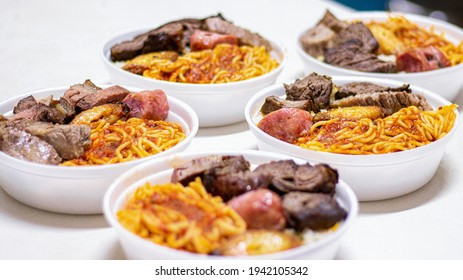 Marmitex with meat, pasta and rice in a white bowl - packed lunch - Brazilian Food.