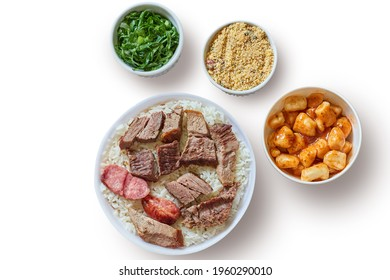 Marmitex with white rice, beans and barbecue with side dish of cabbage, crumbs and gnocchi in a white background - top view.