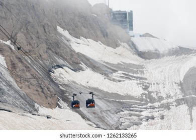 Marmolada, Italy - August 23, 2018: Cable car cabins intersect on the section of the Marmolada glacier, Dolomites