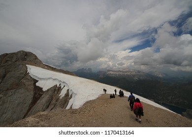 Marmolada, Italy - July, 18, 2018: tourist on Punta Rocca