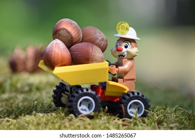 Marmorbyn, Sweden, Summer 2019 Lego minifigure from Minifigures Disney Serie 2. Squirrel (Dale) driving a small vehicle with tasty nuts. Lego is a brand from Denmark.