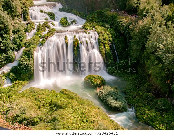 Marmore Falls, a waterfall nestled in a green forest on a beautiful summer day ( Cascata delle Marmore, Umbria, Italia)