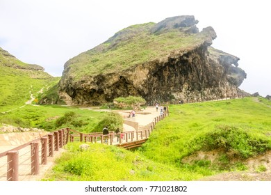 Marnif Cave near Mughsal Beach and at Lush Green Mountains Landscape, Salalah, Sultanate of Oman