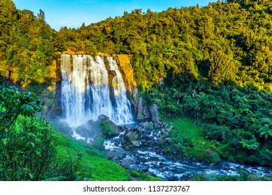 Marokopa falls at sunset. Concept of ecological and active tourism. Exotic journey to the North Island, New Zealand