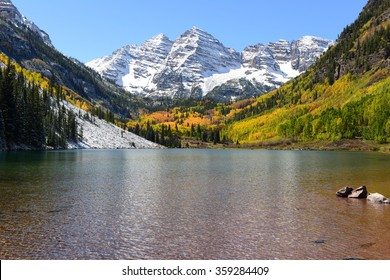 Maroon Bells and Lake in Fall - Autumn view of snow coated Maroon Bells and crystal clear Maroon Lake, Aspen, Colorado, USA.