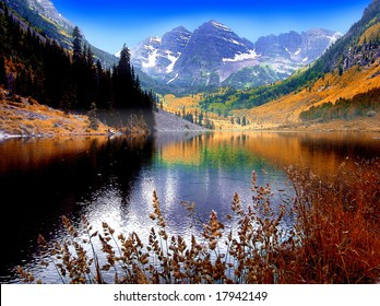 Maroon Bells Mountain Peaks reflected in Maroon Lake near Aspen Colorado, USA.