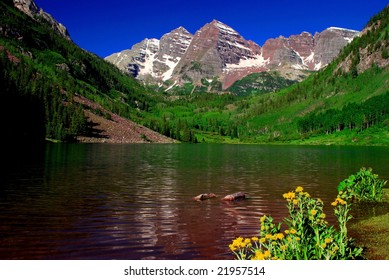 Maroon Bells Mountain Peaks in the summer with Maroon Lake in foreground