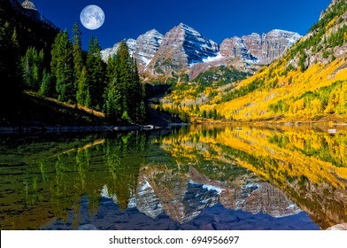 Maroon Bells Reflection with Moon at Maroon Lake near Aspen Colorado.