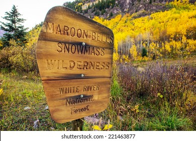 Maroon Bells Snowmass Wilderness - White River National Forest Wooden Sign near Maroon Bells, Aspen, Colorado, United States.
