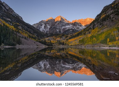 Maroon Bells Sunrise. As you might think, Maroon Bells was packed with 1000s photographers during fall season. The government roped the shore and we may not be able to capture water reflection