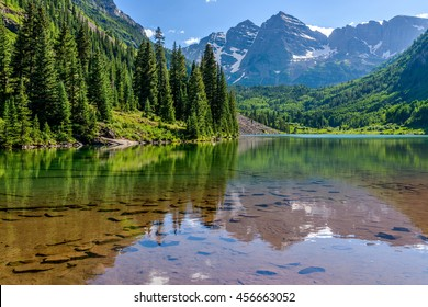 Maroon Lake - A Spring evening at colorful Maroon Lake, with Maroon Bells rising in the background, Aspen, Colorado, USA.