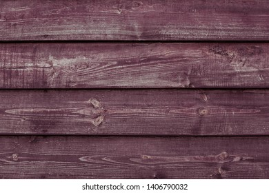 Maroon wood texture background. Vinous wooden plank surface. Burgundy wooden shabby table, fence, barn. Abstract pattern of red lumber, brown logs. Rough boards, weathered timber, hardwood, grunge flo