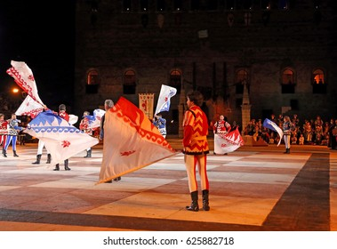 Marostica, VI, Italy - September 9, 2016: flag wavers during night great show with Evolutions of huge flags