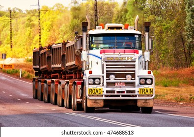 MARRAKAI,AUSTRALIA - AUGUST 23,2016: A road train travels along the Arnhem Highway in the outback. Many remote communities rely on road trains to transport ore, fuel and cattle.