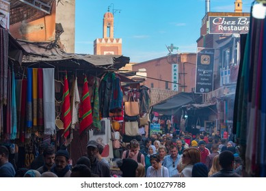 MARRAKECH - DEC 31: Crowd of people at an old market in medina district in Marrakech on December 31. 2017 in Morocco