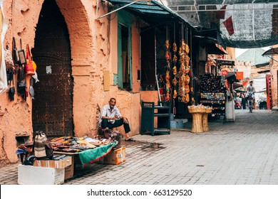 MARRAKECH, MOROCCO. 10th June, 2017: portrait of street vendor selling moroccan handicrafts at Marrakech Medina