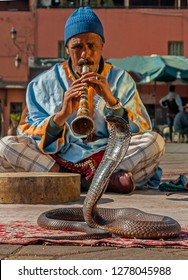 Marrakech, Morocco, 15 January 2013: Snake charmer playing music, Marrakech, Morocco