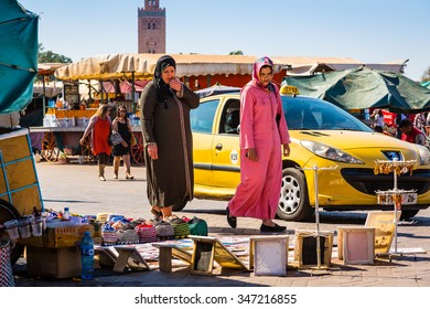 Marrakech, Morocco - 30 October 2015: Moroccan Women in typical clothing on Jemaa el Fna square in Marrakesh