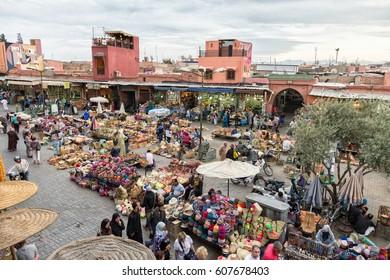 MARRAKECH, MOROCCO - APR 28, 2016: Tourist visiting a berber market in the souks of Marrakesh.