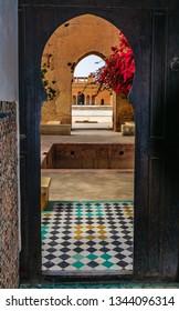 MARRAKECH, MOROCCO - APRIL 12, 2017: Looking through doors in the Medina of Marrakech, Morocco