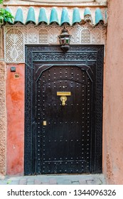 MARRAKECH, MOROCCO - APRIL 12, 2017: Black door in the Medina of Marrakech, Morocco