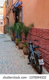 MARRAKECH, MOROCCO - APRIL 12, 2017: Empty street with a motorbike in the Medina of Marrakech, Morocco