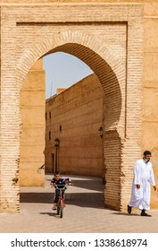 MARRAKECH, MOROCCO - APRIL 12, 2017:Local boy and man in front of a gate in the Medina of Marrakech, Morocco