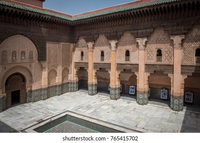Marrakech, Morocco; April 19 2017: The main patio of the Madrasa Ben Youssef, one of the biggest religious universities in Morocco. A photograph exposition under the balconies.