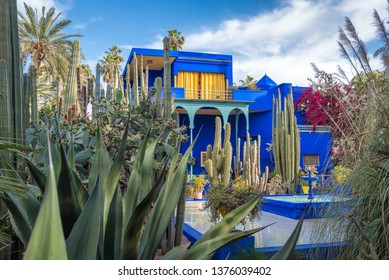Marrakech, Morocco - April 2019:  Beautiful view of Majorelle Garden featuring a Cubist villa designed by Paul Sinoir and purchased by the fashion designers, Yves Saint-Laurent and Pierre Bergé