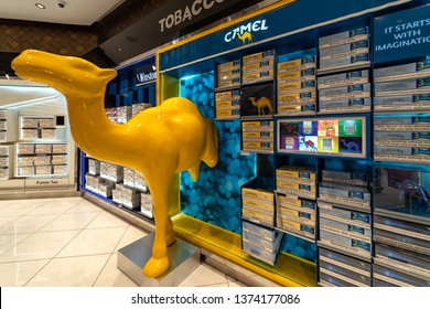 MARRAKECH, MOROCCO - APRIL 2019: Camel cigarettes inside duty free shop at the Menara airport. Camel is a brand owned by JTI - Japan Tobacco International.