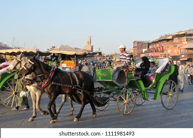 Marrakech, Morocco - april 24, 2016: Horse carriage with Moroccan family inside, circulating in Jemaa el Fna square, in the historic center of the city