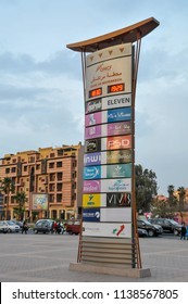 Marrakech, Morocco - april 24, 2016: Advertising column in a central avenue of Ville Nouvelle, the new part of the city, at sunset